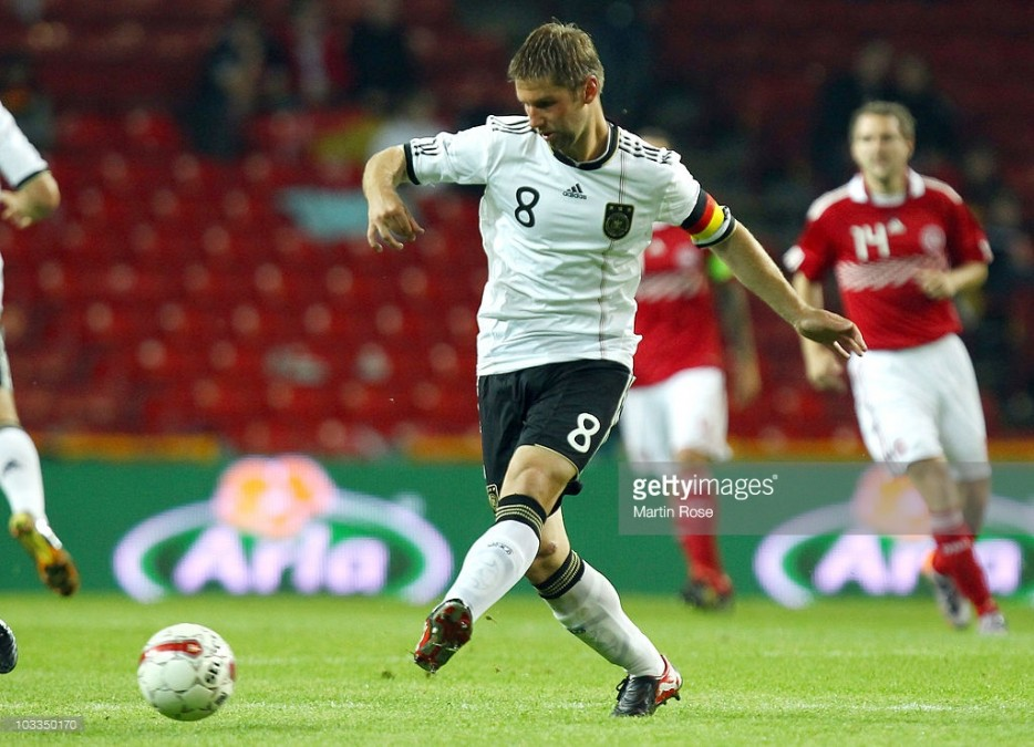 COPENHAGEN, DENMARK - AUGUST 11: Thomas Hitzlsperger of Germany runs with the ball during the International Friendly match between Denmark and Germany at Parken stadium on August 11, 2010 in Copenhagen, Denmark. (Photo by Martin Rose/Bongarts/Getty Images)